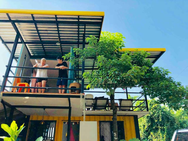 A 2-storey container home in peaceful jungles.