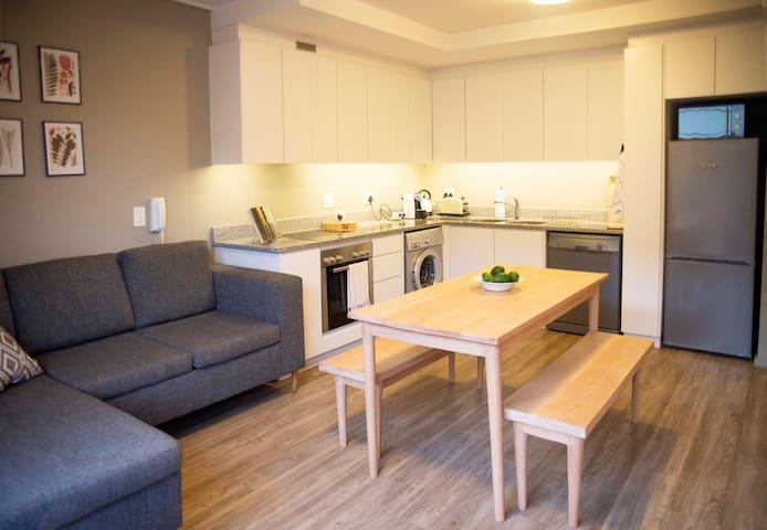 Open plan living area with kitchen (coffee machine + dishwasher + washing machine + SmartTV with Netflix)