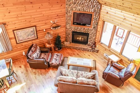 Lutsen Log Lodge 24 is located in the heart of Lutsen across the road from the Superior National Golf Course