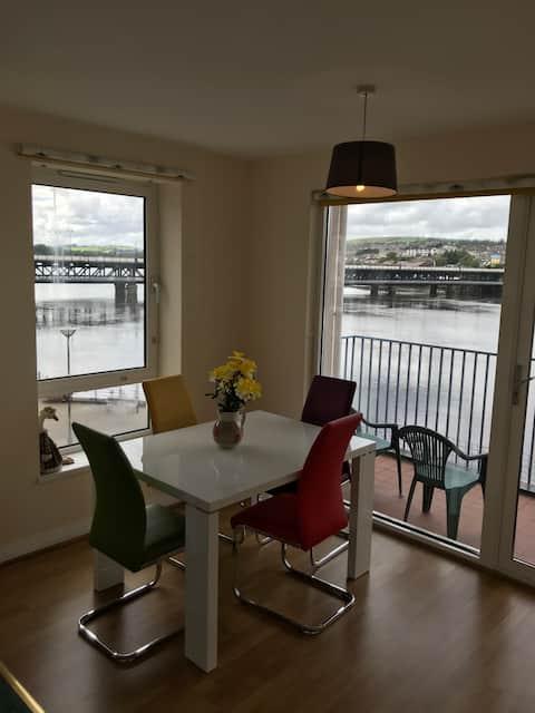 Riverside apartment city views