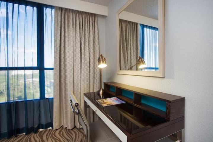 Each room includes laptop friendly work station