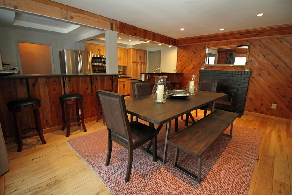 Large dining table open to living room and kitchen
