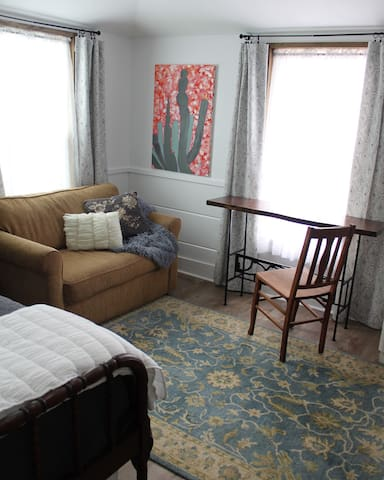 The room offers a loveseat/sofa sleeper, as well as a custom made, mesquite table. The natural light allows for the perfect place to finish up a meal or type up that important email.up