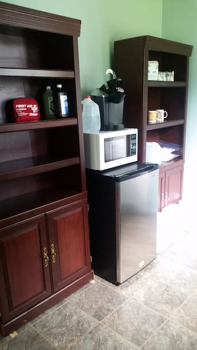 Kitchenette has a mini-fridge, microwave and a Keurig coffee maker as well as complimentary organic coffee and sweetener.