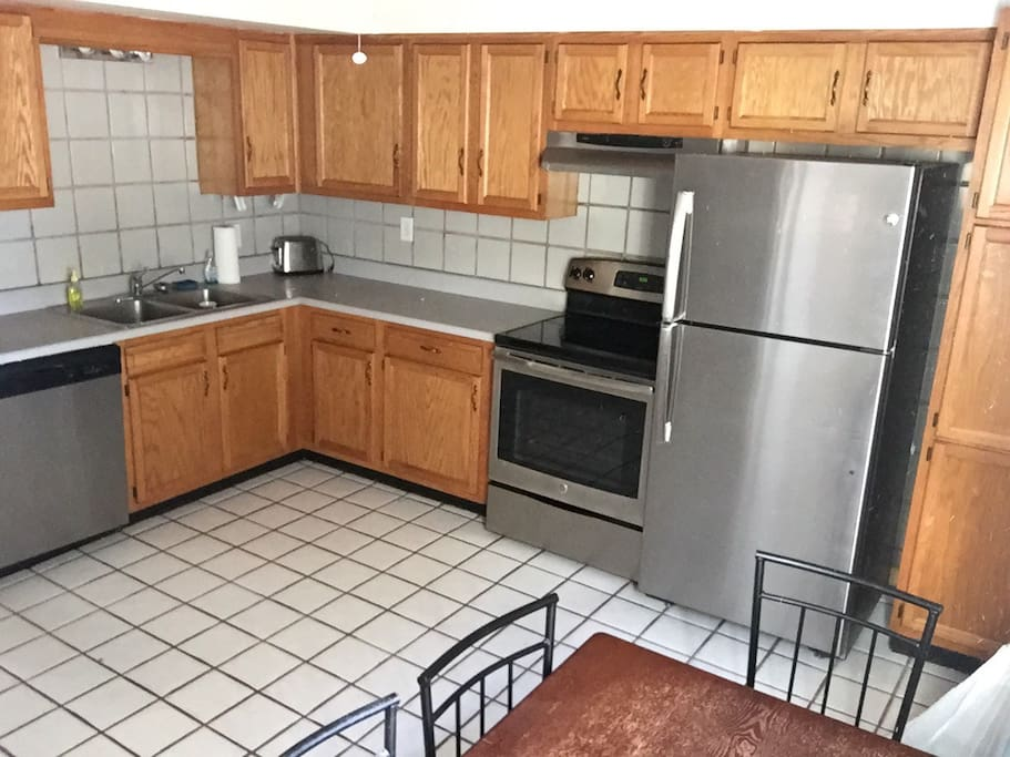 Full size kitchen. Dishwasher toaster and coffee maker