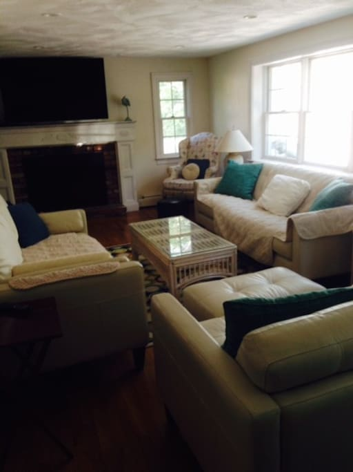 Family Room with new leather furnishings, chaise, and large HDTV.
