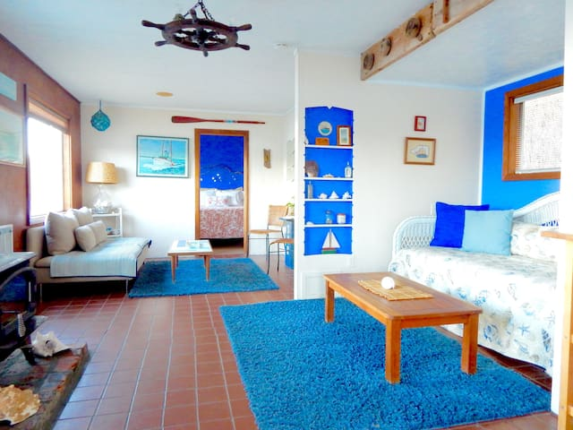 Sunset Marine Resort ~ Clam Cottage interior, 1 room with trundle in living room and full kitchen.