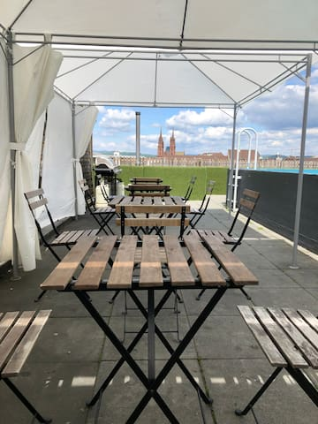 Enjoy dinner on the rooftop with a view to the münster church