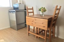 Dining for 4 with extendable table; fridge and microwave oven