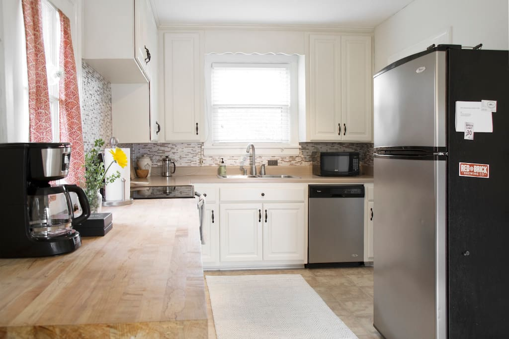 Kitchen equipped to handle all cooking needs and Whirlpool stainless appliances.