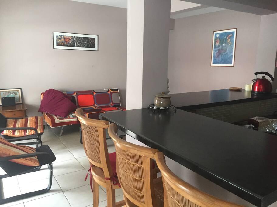 Lounge, corner of breakfast bar and kitchen