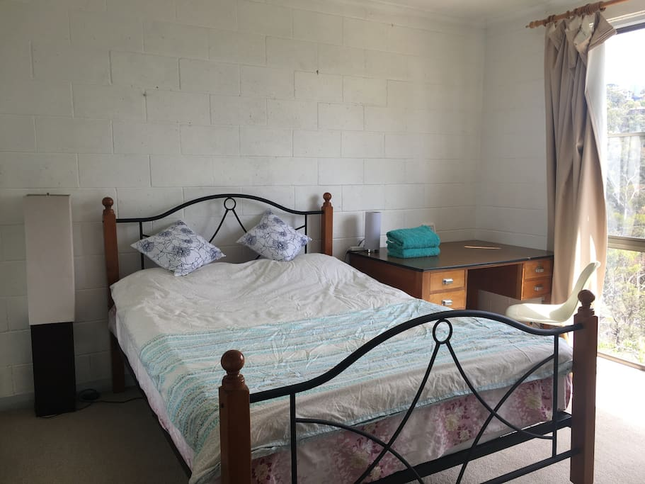 master room with one queen bed and one single bed as spare. TV is provided in both master room and lounge. You know, family together may want to watch their own favorite program. Two TVs are easy to avoid fighting.