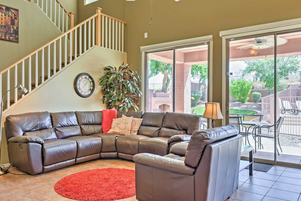 Unwind in this spacious living room on the cozy leather sectional.