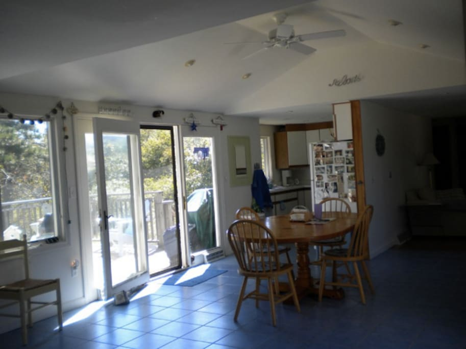 kitchen with french doors to back porch and custom dining table
