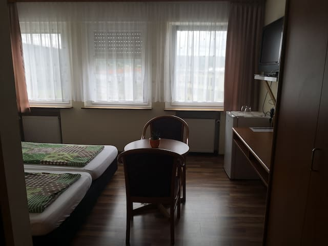 Double room-Classic-Ensuite with Shower-City View-1.OG