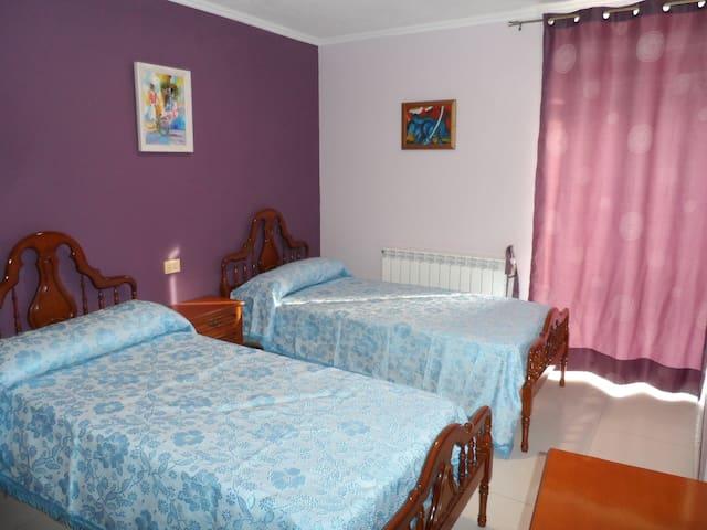 Dormitorio camas gemelas