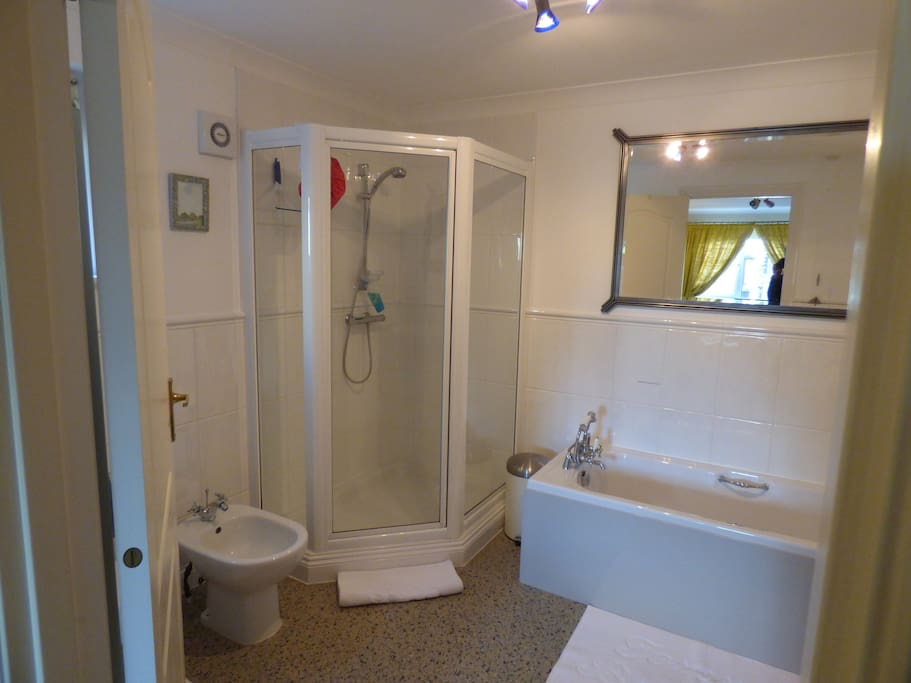 En suite bath and separate shower
