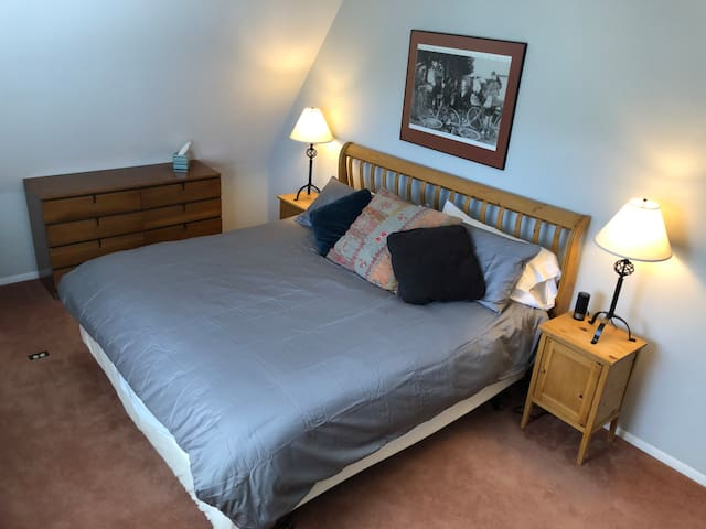 2nd Level Bedroom #3 with king bed, TV, great views & easy access to shared full bath.