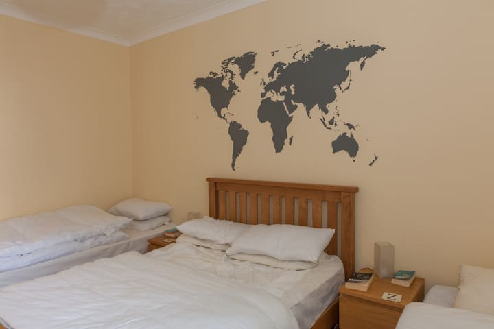 Main bedroom with New Oak Double bed with three single beds...