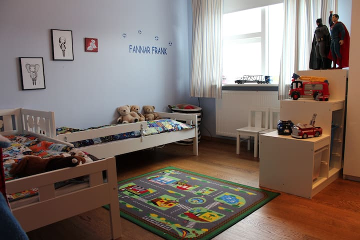 The toddler room has plenty of toys, books and balls of various kind.