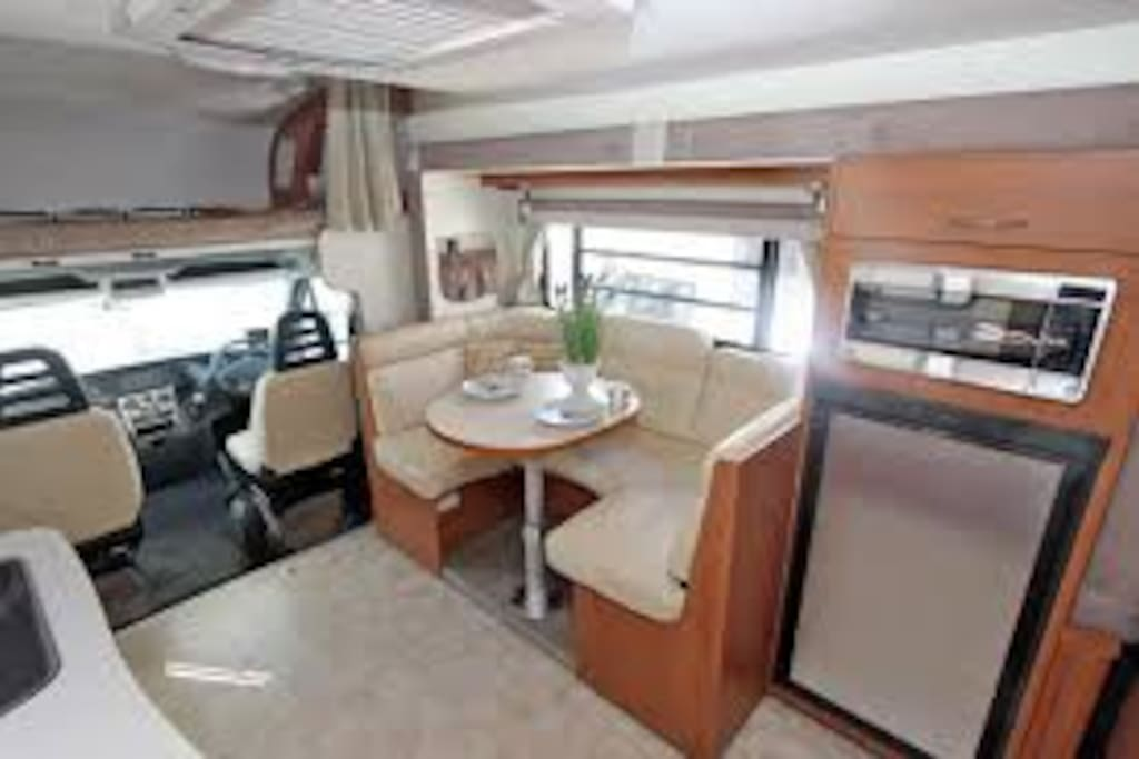 """This motor home is a """"slide out"""" model making it quite spacious and well venitilated with lots of louvred windows."""