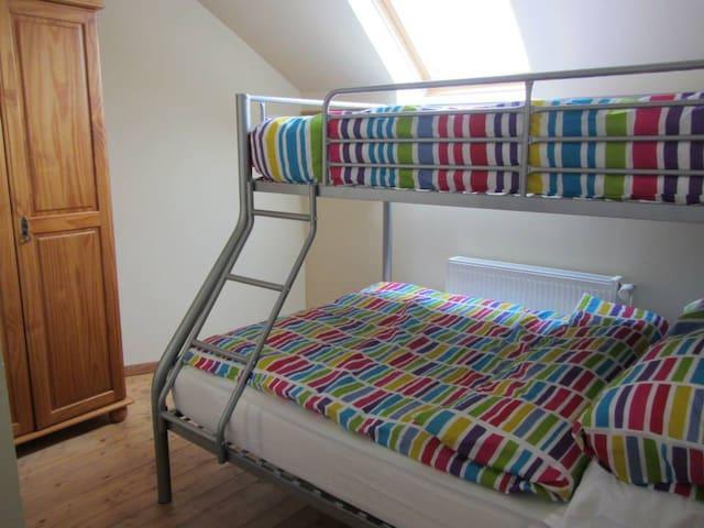 Bedroom 2 - double bottom bunk, single on top