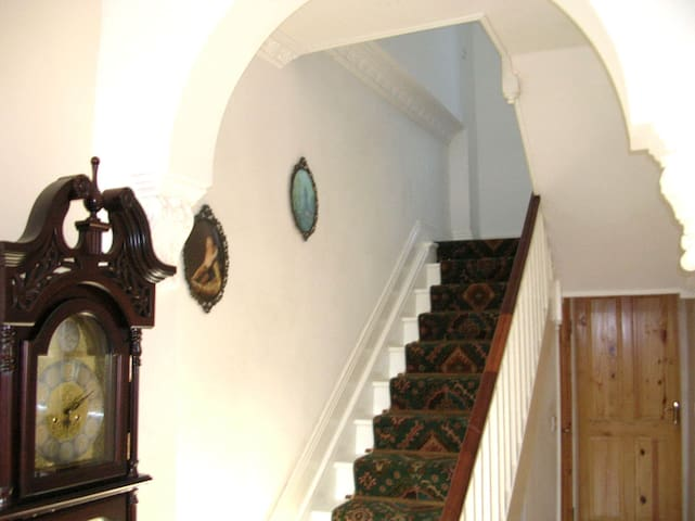 Back hall, Stairs, and Door of bedroom One. .