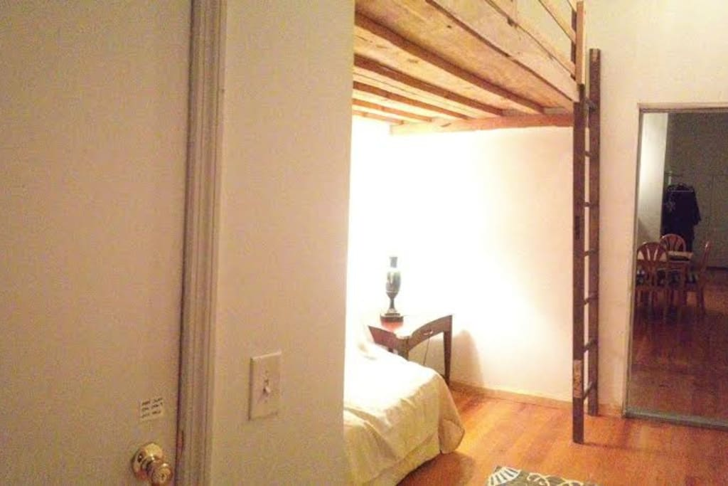 The bedroom with awesome vintage wood bunk bed (the view from the closet point)