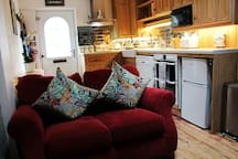 Lounge kitchen area. Smart tv. Dishwasher, fridge freezer induction hob, microwave. Washing machine and dryer in laundry area in the garden