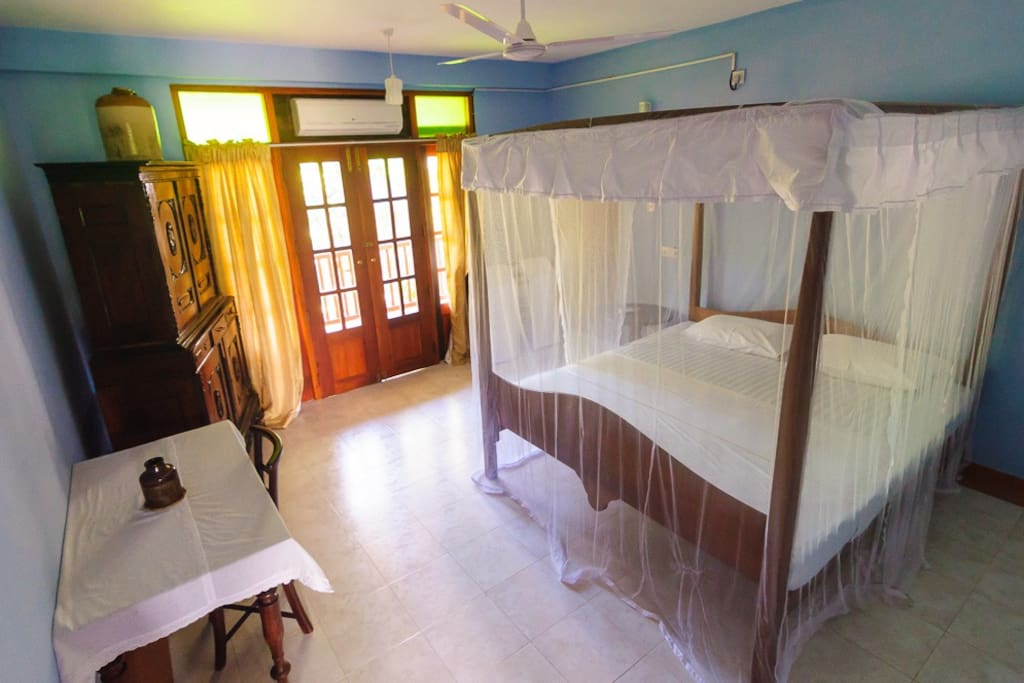 bedroom with AC and ensuite bathroom