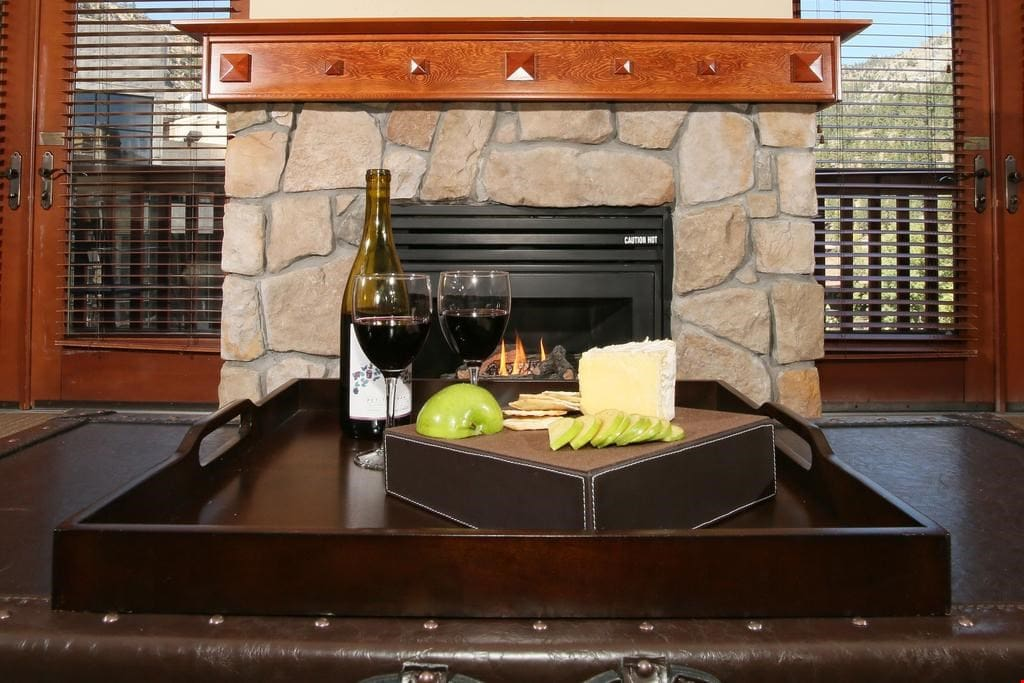 Feel right at home in the living area featuring a stone-fronted gas fireplace!