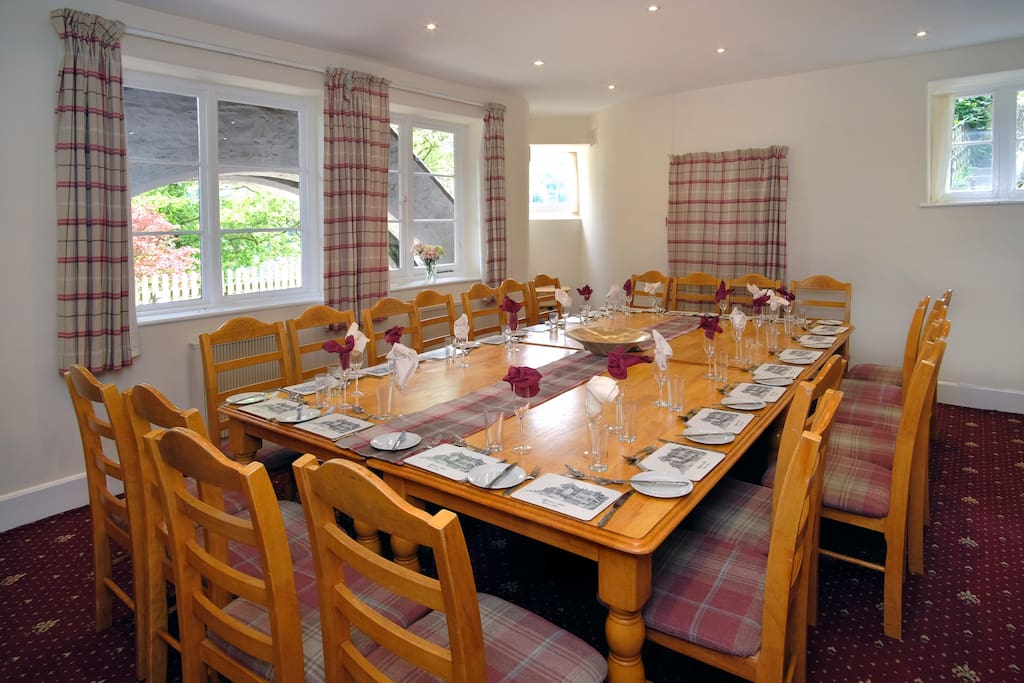 The dining room seating up to 24 guests adjacent to the kitchen