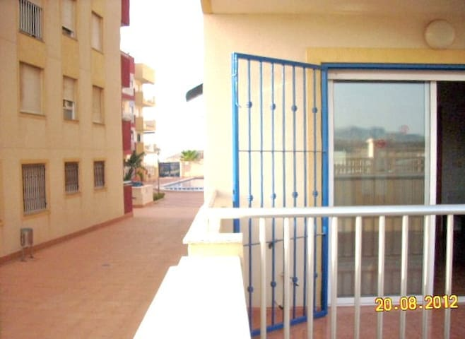 Your terrace with the pool just along the passageway