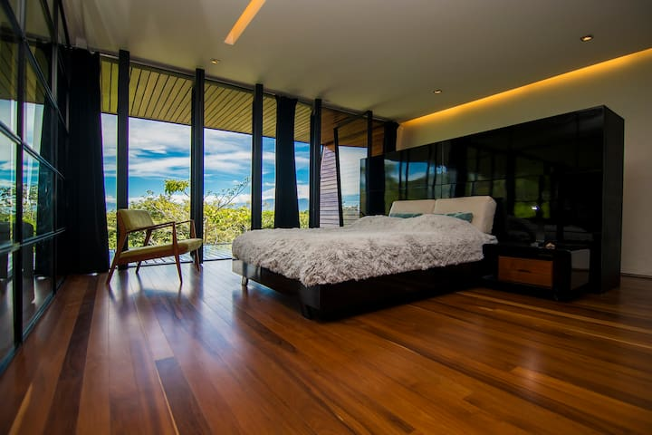 Master bedroom opens up to an ample private terrace . Hardwood floors on all areas of this level of the Villa.