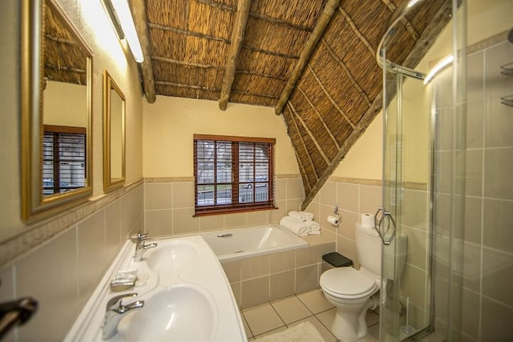Full ensuite Bathroom including bath and shower with complimentary daily amenities