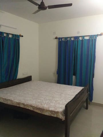 Bedroom adjoining living room in ground floor