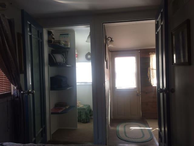 Closet/ back porch to deck outback-   Smoking area