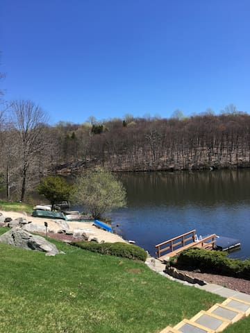 Private sandy beach and dock includes four boats for your enjoyment