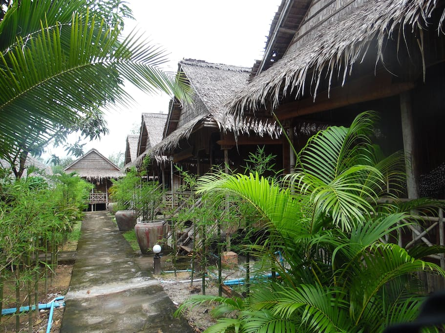 Bamboo Bungalow with beautiful garden right at beach.