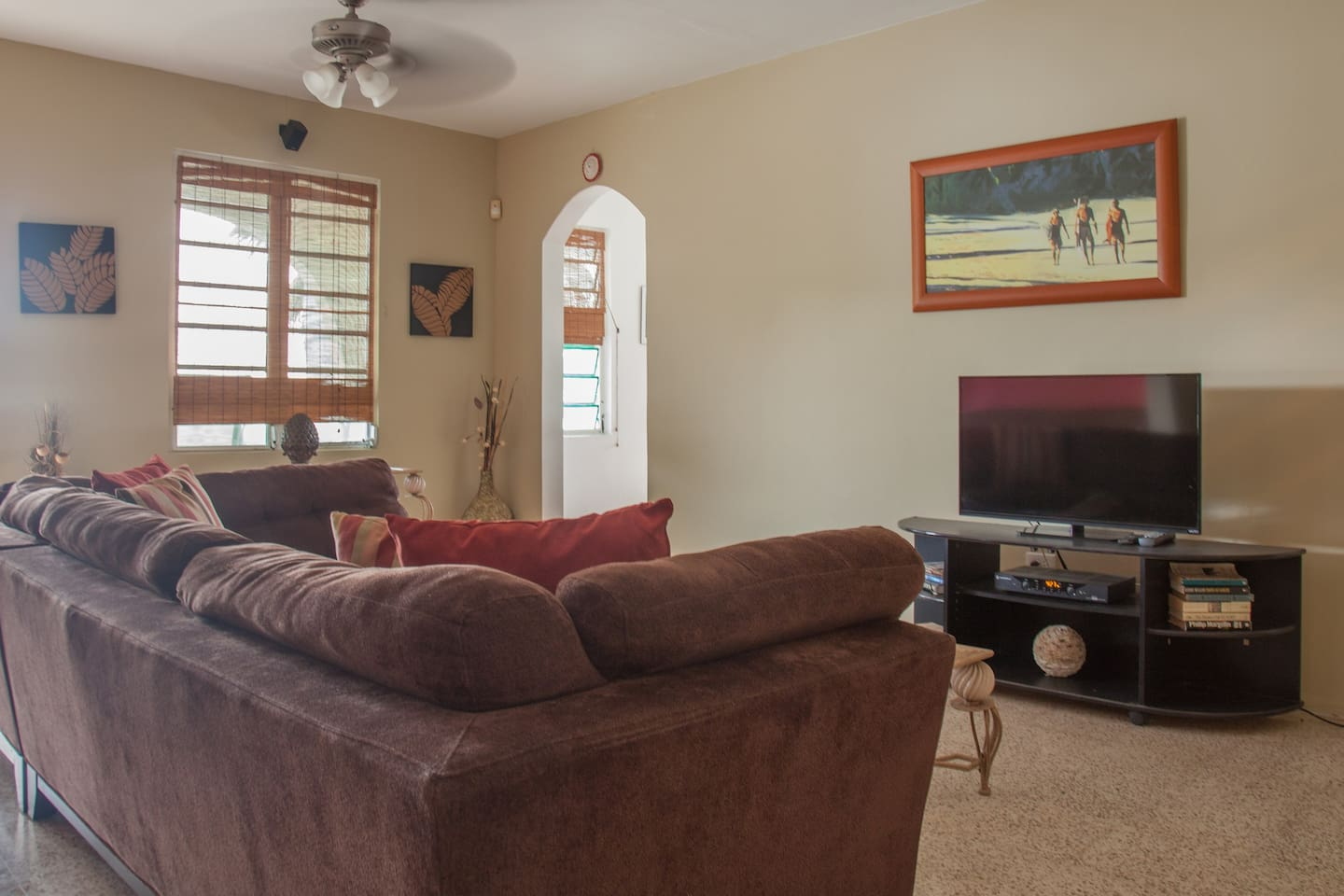 Huge comfortable living room with smart TV and plenty of seating.