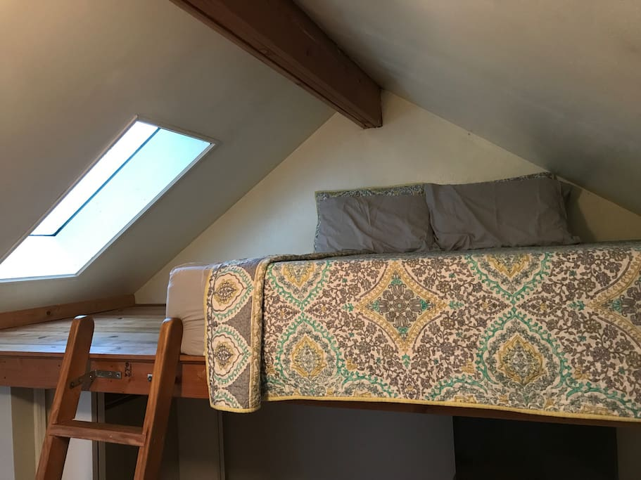 lofted queen mattress with extra floor space and skylight