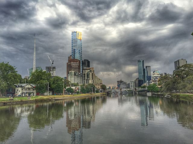 A classic view of the Yarra river with the Iconic Eureka Tower hovering over the city.