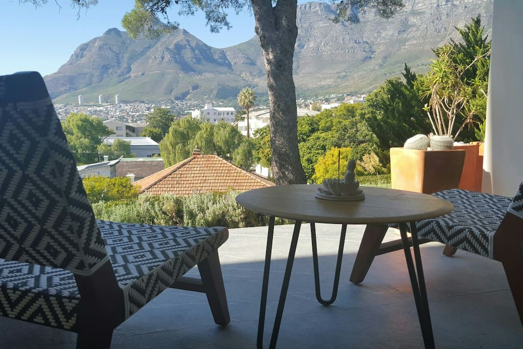 Breathtaking views over Cape Town City Bowl,  Table Mountain and Signal Hill from the ground floor guest bedroom.