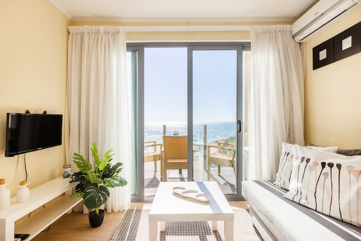 Living Area with Flat-Screen TV, Sofa-Bed and Balcony with Sea View