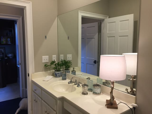 Large Bathroom with tub and shower.