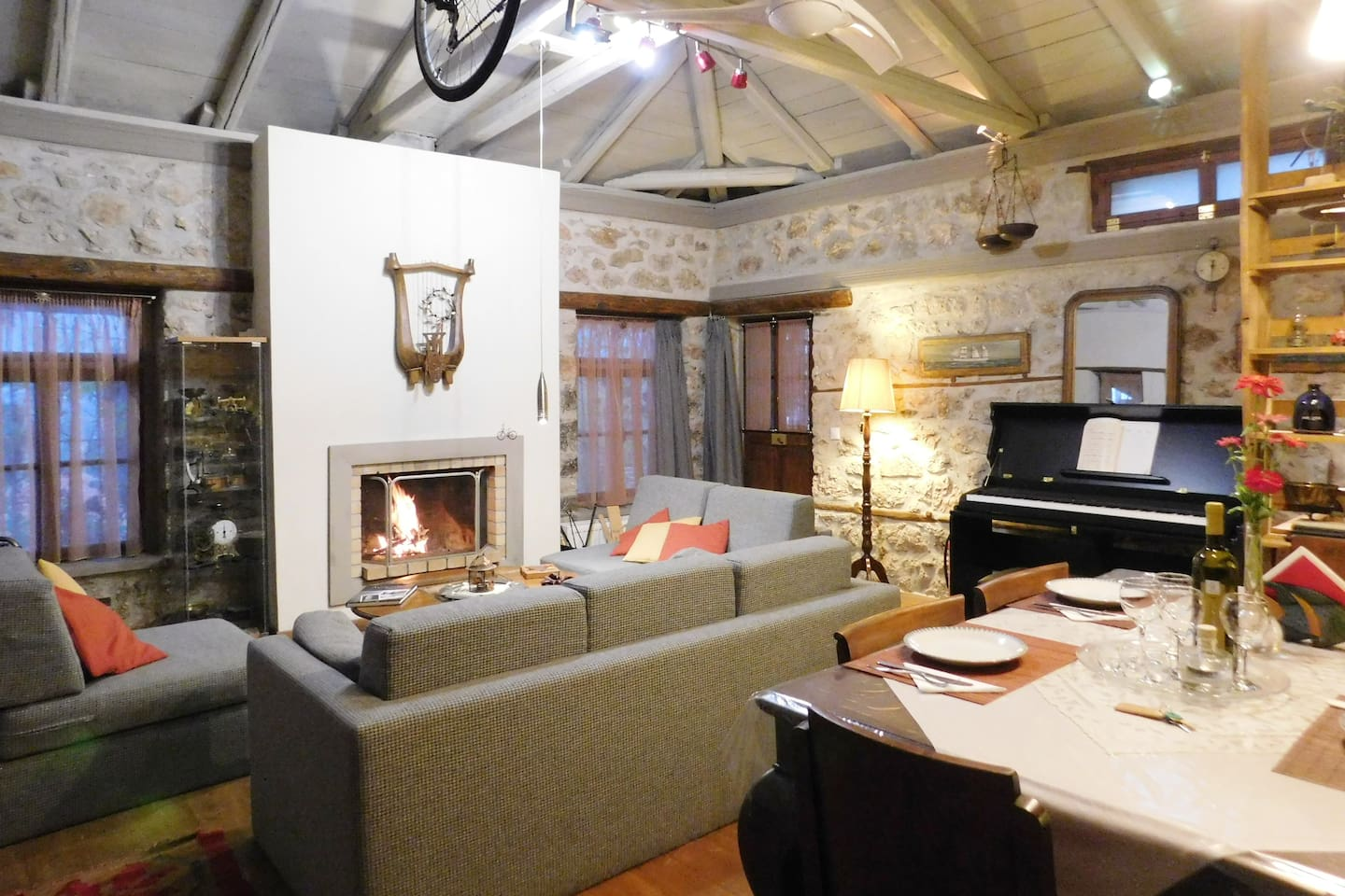 The open living space with the fire place and the piano.