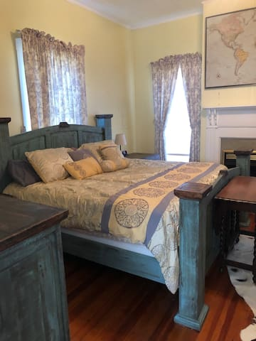 King size bed. Bedroom with fireplace.