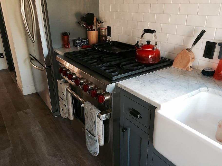 Cooking - Wolf Stove, breakfast bar, nook table, french doors to deck