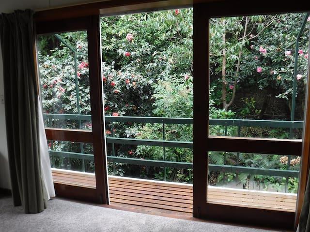 Balcony with garden view in the Kiwi Room (Bedroom #4)