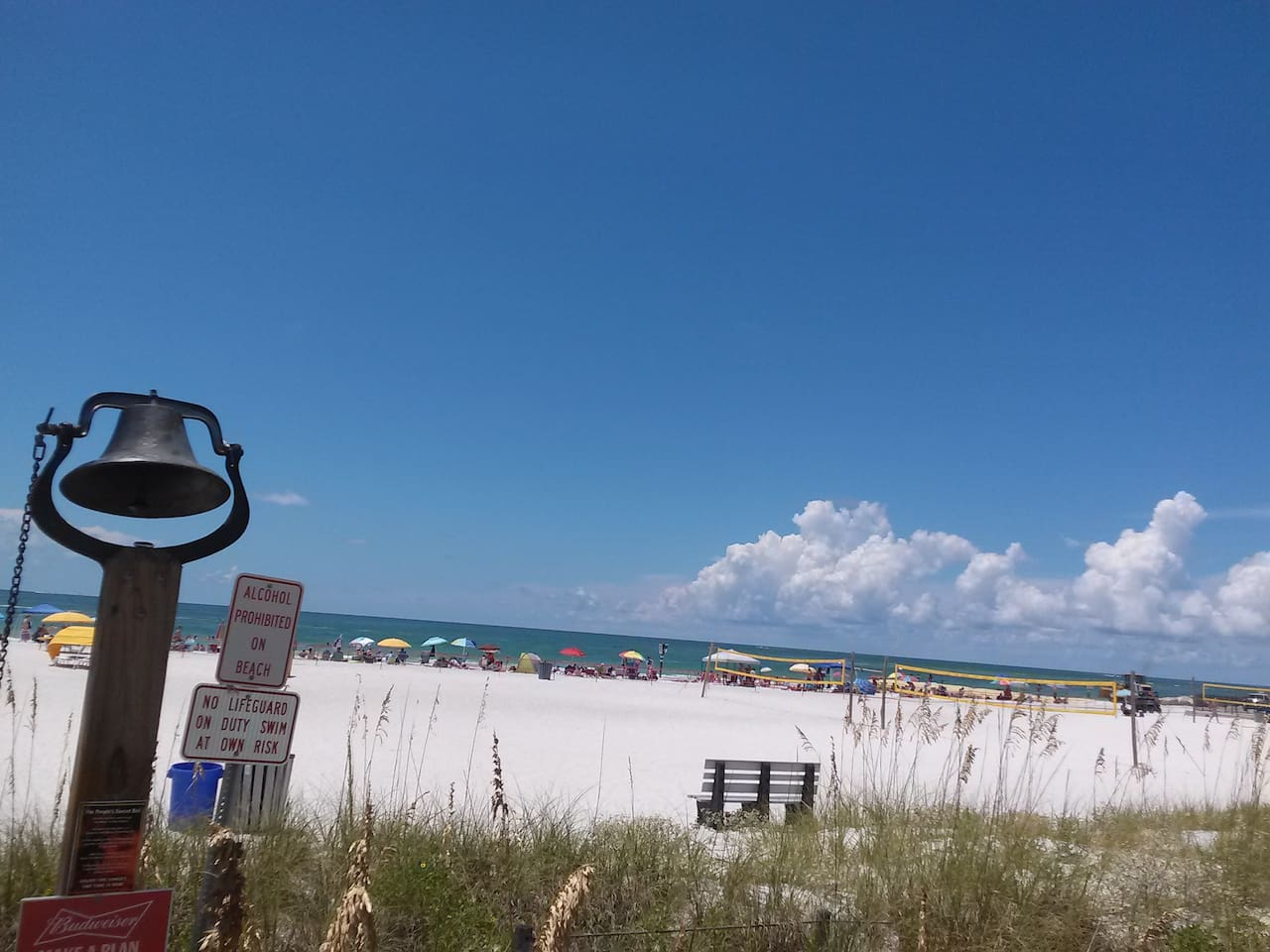 Beach with multi-volleyball courts. There is a volleyball for your use at the condo.